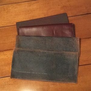 Four vintage insurance policy pouch holders. Used